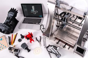 photograph of desk in a hacker space used to make 3d printed parts